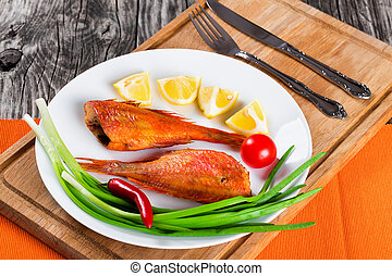 Red Sea Bass on a white dish - Red Sea Bass on awhite dish...