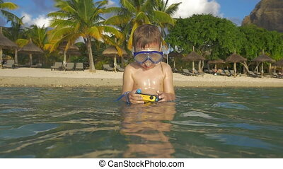 Kid bathing with waterproof camera - Slow motion shot of...