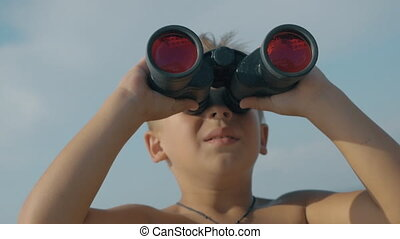 Child exploring the world with binoculars - Slow motion...
