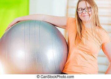 Exercise Ball Time. Young Caucasian Girl with Large Exercise...