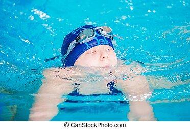 Swimming Girl in the Pool. Teenage Caucasian Girl in the...