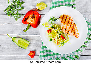 grilled chicken breast fillet with vegetables salad, top view