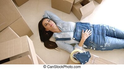 Attractive young woman relaxing on the floor - Attractive...