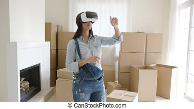 Woman interacting with her virtual environment - Young woman...