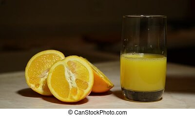 Pouring a glass of freshly squeezed orange juice