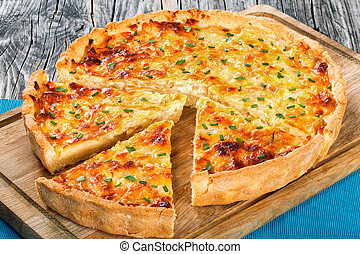 French onion cheese quiche, view from above, close-up -...