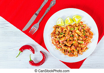 Marinated Pig Ears with spices, pieces of chili pepper -...