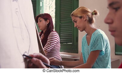 Art School With Teacher And Students Painting In Class -...