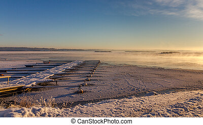 Winter landscape with frozen marina at coast Norway,...