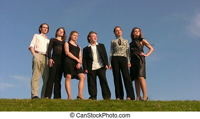 six young persons stands on hill - group from six young...