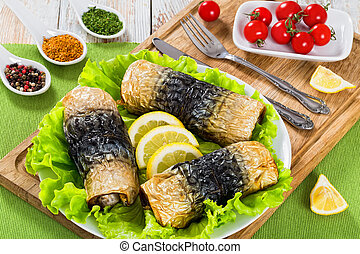 baked fillet of mackerel on lettuce salad on white platter