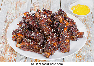 Chinese spicy fried Ribs on white dish, close-up - Chinese...
