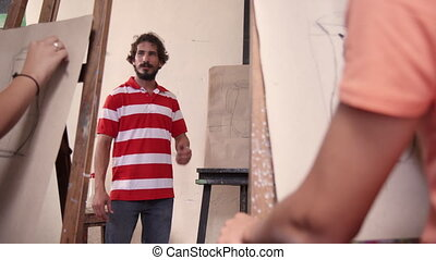 Man At Work As Teacher In Art School With Students