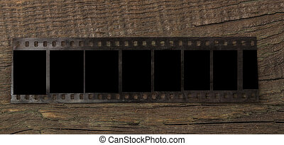 blank film strip on wooden table