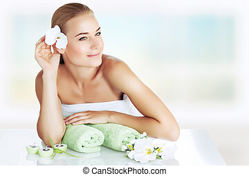Enjoying day spa - Portrait of a beautiful young woman...