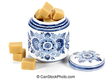 fudge in Delftware container isolated on white background