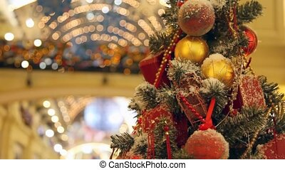 artificial tree decorated with spheres and beads in shopping centre