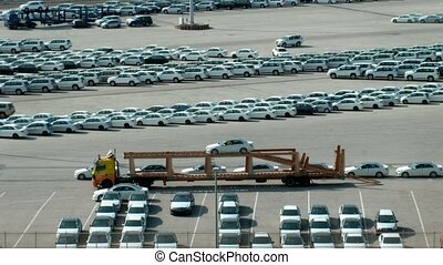 Parking of cars, loading of cars on a lorry, on sunny day...