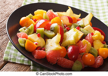 Exotic Food: salad of orange, kumquat, pineapple, carambola,...