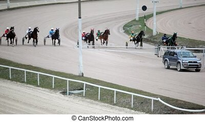 jumps of running horses with jockeys and autostart car -...