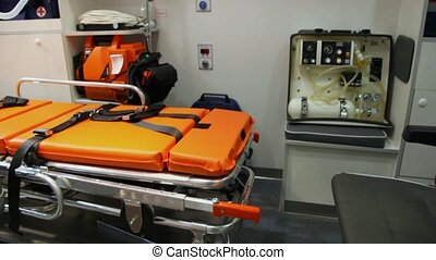 ambulance car inside with couch, armchair and equipment -...