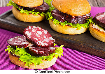 sandwiches with butter, lettuce and slices of smoked sausage...
