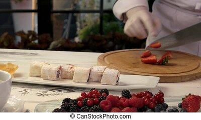 Chef cutting strawberry.