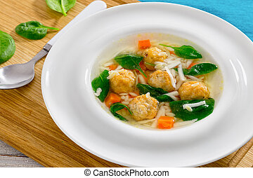 delicious wedding soup with meatball, carrots and spinach