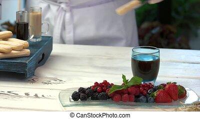 Ingredients of tiramisu. Chef dipping savoiardi in coffee.