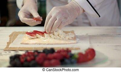 Chef's hands making dessert.