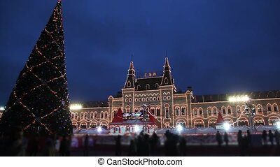 skating rink and New Year tree on Red Square in Moscow at...