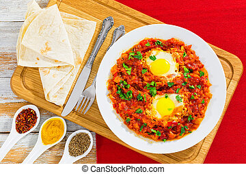 shakshuka - eggs,bell pepper, chili, tomato sauce and spices...