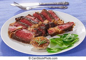 hot beef rib-eye meat juicy steak, close-up