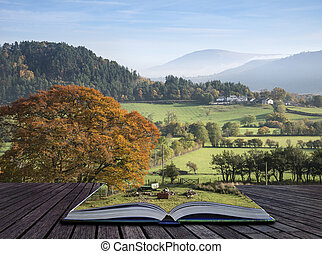 Beautiful Autumn Fall sunrise foggy landscape image over countryside in Lake District in England coming out of pages of book