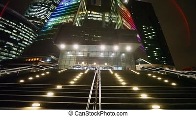panorama of main ladder input in business centre at night -...