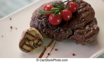 Steak with cherry tomatoes. Grilled garlic and herbs. Fresh...