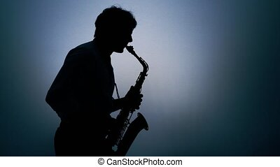 Saxophone player over a grey background.