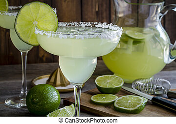Classic Lime Margarita Drinks - Close up of table filled...