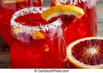 Fresh Blood Orange Margaritas - Close up of blood orange...