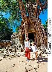 Ta Som temple - Family visiting ancient Ta Som temple in...