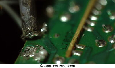 the process of soldering wires to the chip Macro - process...