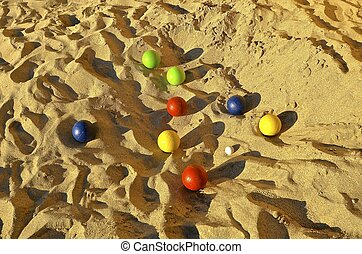 Bocce ball game on the sand - A game of bocce ball on the...