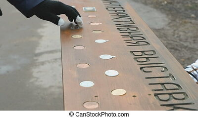 Person choosing russian commemorative coins - Person...