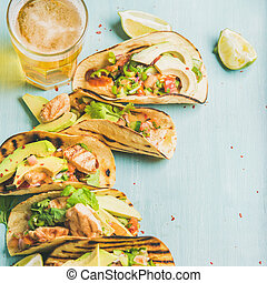Corn chicken and avocado tortillas, beer in glass, square...
