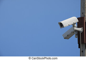 security cameras on blue background