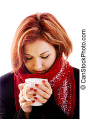 girl in winter clothes with cup - portrait of girl in winter...