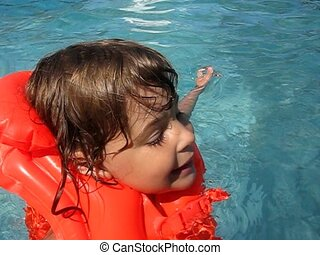 swimming girl in outdoor water pool - swimming little girl...