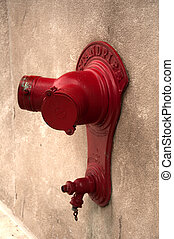 Standpipe - Bright red standpipe on a downtown Chicago wall