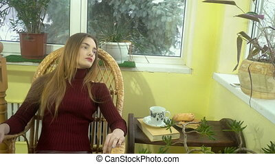 beauty young woman with nice make up sits in the wicker...