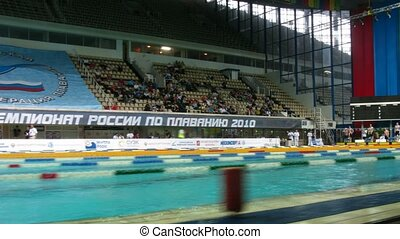 People move in places before competitions on swimming